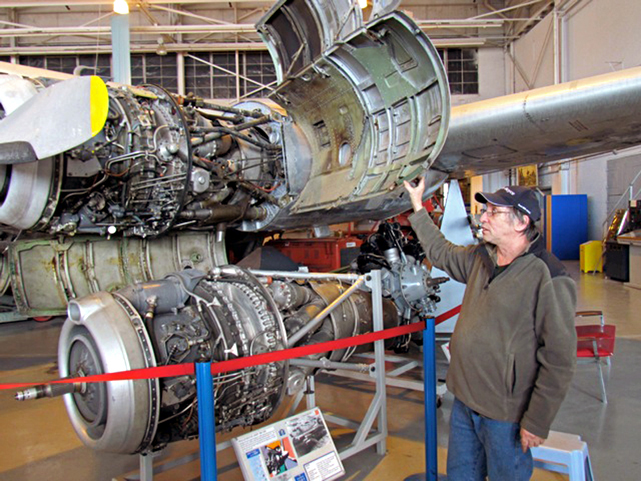 Robert pointing out how the 'clam-shell' doors open to expose the Rolls-Royce Dart RDa3 Mark 506 engine for maintenance.