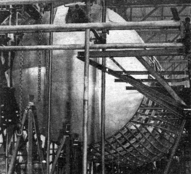 As may be seen from this photograph of the aft pressure bulkhead and fuselage, the first prototype is well under way.
