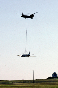 Airlifted by a Canadian Armed Forces Boeing Vertol Chinook helicopter to a nearby landfill site.